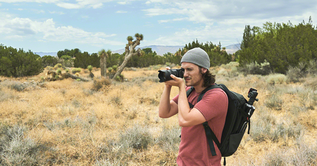 man using sony a6600 for landscape