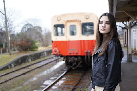 Portrait of woman at train station
