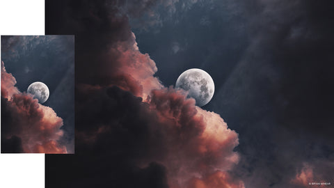 Moon behind red and black clouds