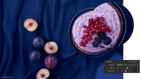 Top down photo of fruit pie on blue table cloth