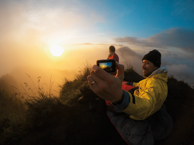 GoPro Hero8 photo of man on mountain taking photo with gopro hero8
