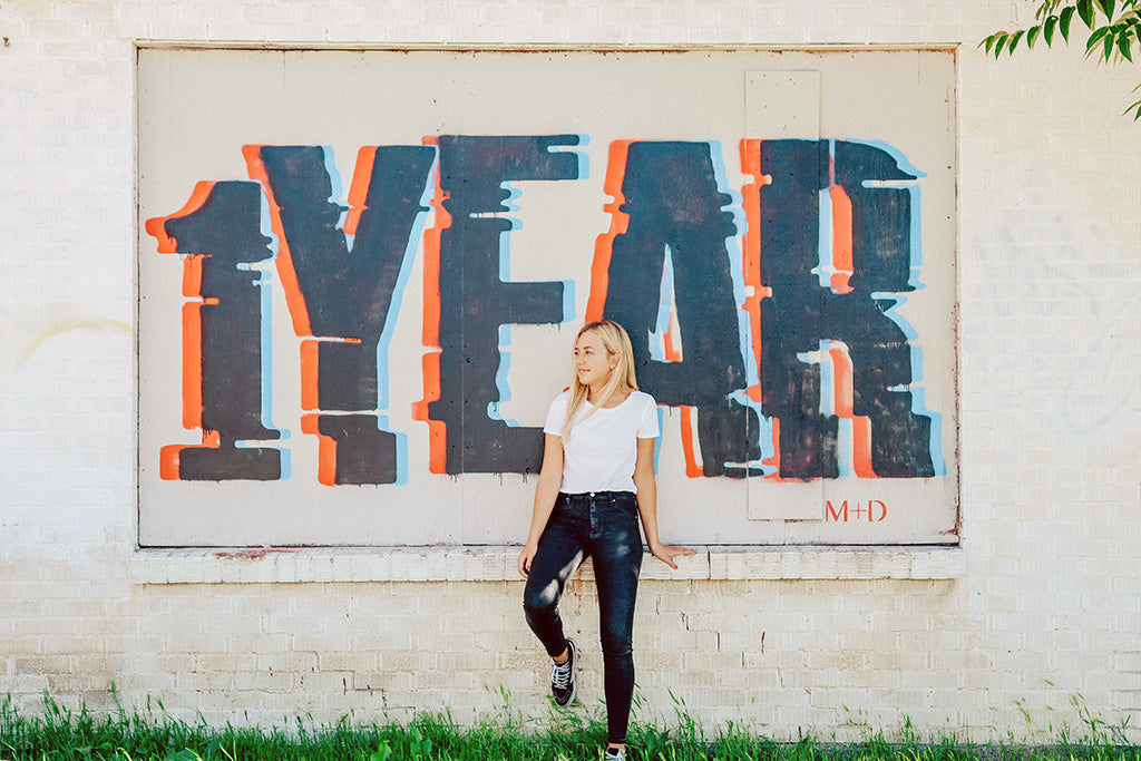 Image taken with Canon eos rebel SL3 of girl in front of 1 year sign