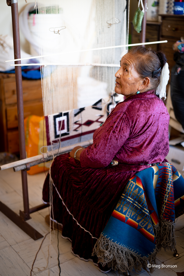 portrait of lady making a blanket for Navajo nation relief project
