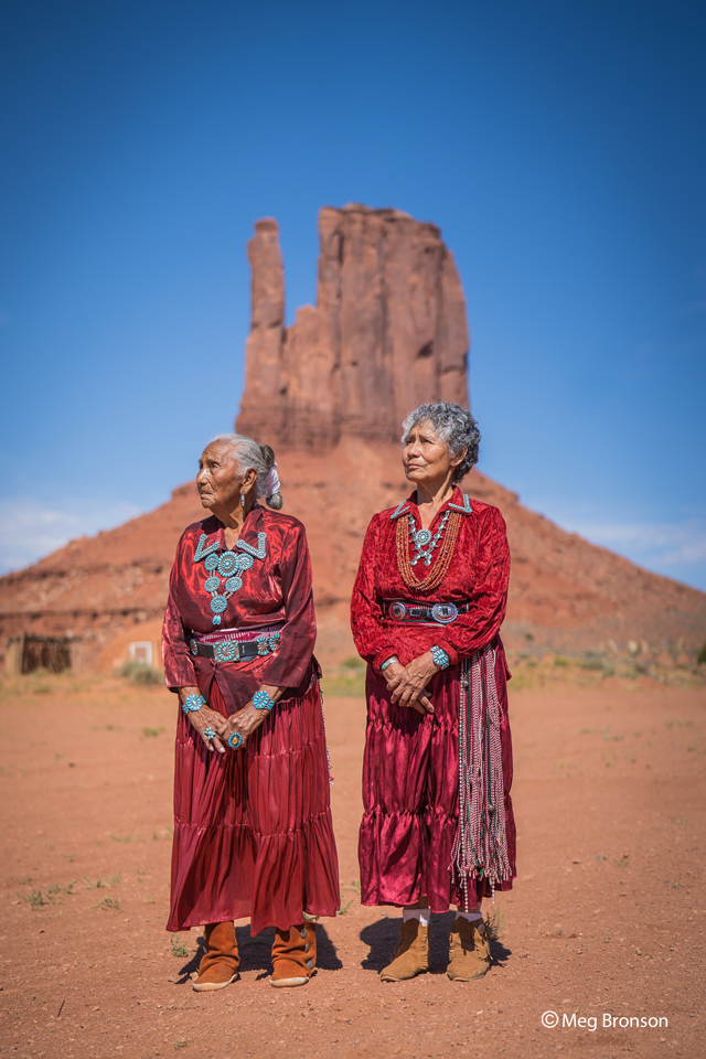 portrait of women by mitten for Navajo nation relief project