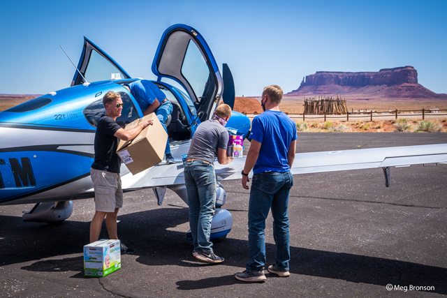 Najajo nation relief project grabbing supplies from airplane
