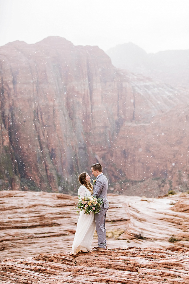Image of bride and groom in southern utah with mountains by Jessica Parker