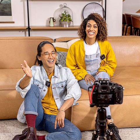 Youtubers on a couch filming themselves