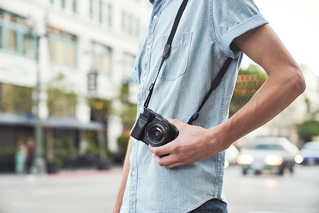 Sony a6100 on shoulder strap
