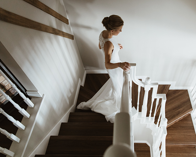 Chelsea Fabrizio photography image of bride walking down stairs