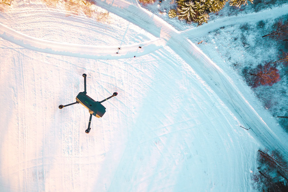 Drone flying above snowy conditions