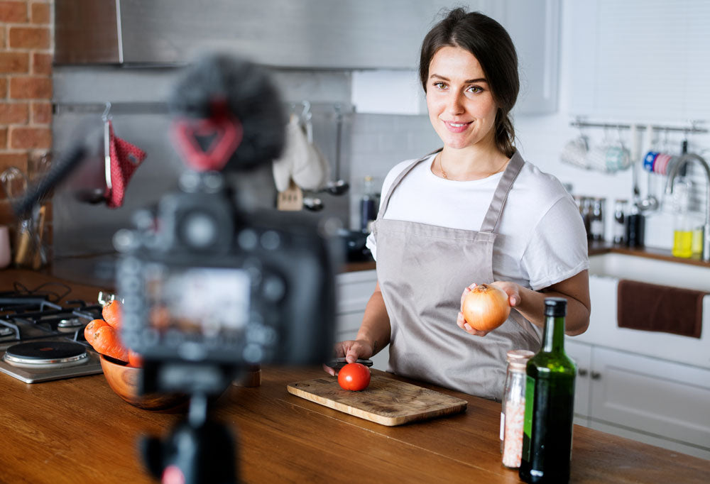 vlogger creating video content of food