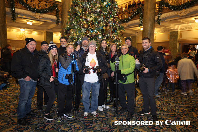 Group shot of the pictureline holiday photo walk attendees by christmas trees