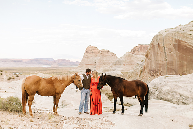 Image of couple with two brown horses in southern utah by Jessica Parker