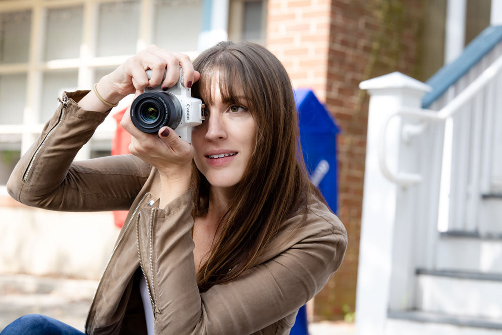 woman using the canon m50 mark ii