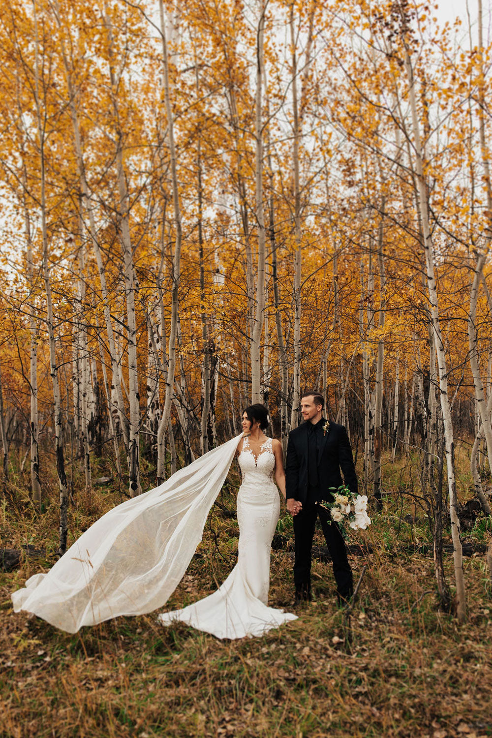 bride and groom in jackson hole taken by nicole aston