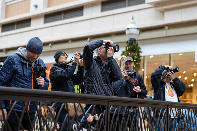group of photographers taking photos of the holiday shoppers at city creek