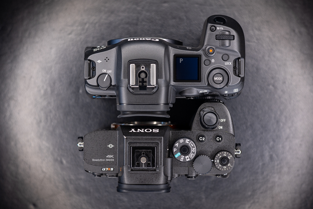 the top of both the canon eos r5 and the sony a7riv
