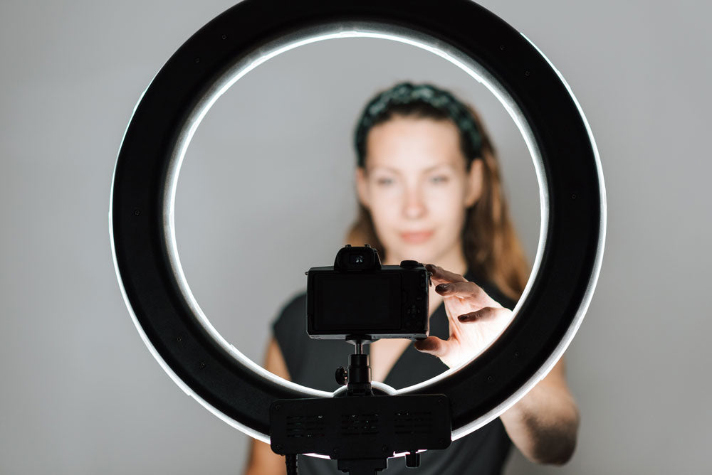 woman using a ring light for her video