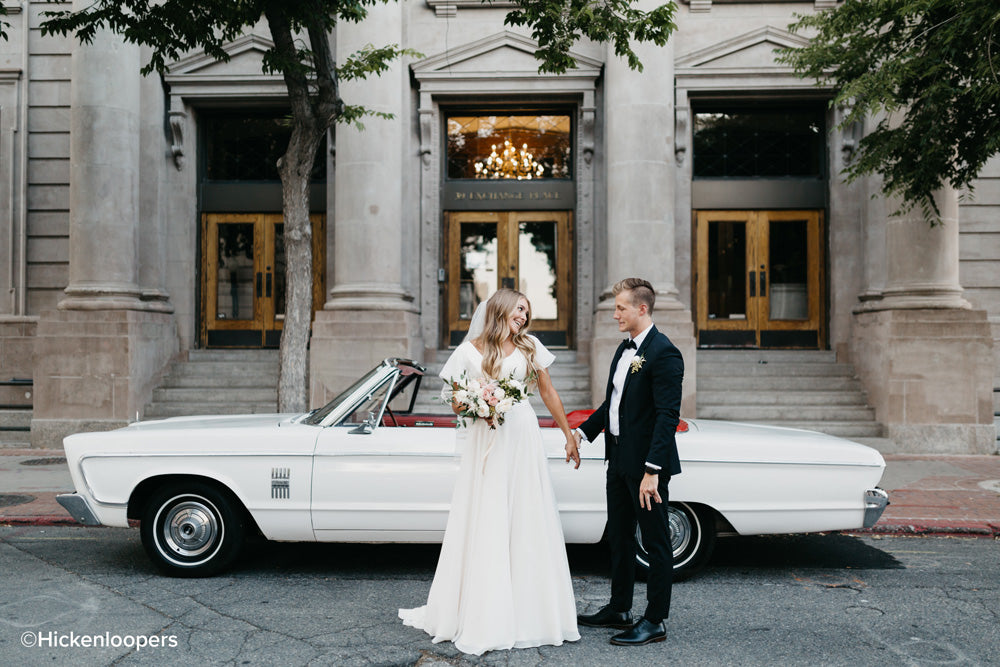 bride and groom by white car by scott hickenlooper