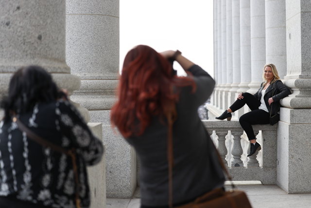 photographers taking photos of female model at the utah state capitol building