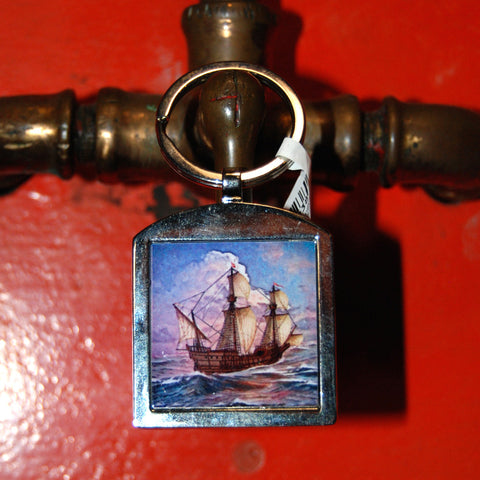 San Salvador metal fob keychain with museum logo on back.