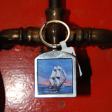 HMS Surprise metal fob keychain with museum logo on back.