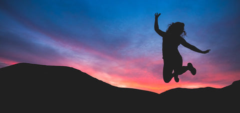 Girl jumping in the sunset