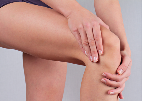 a person trying to relieve joint pain