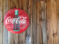 Coca Cola sign on wood