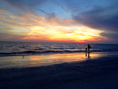 Father son at beach with perfect sunset