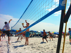 Volleyball game on beach