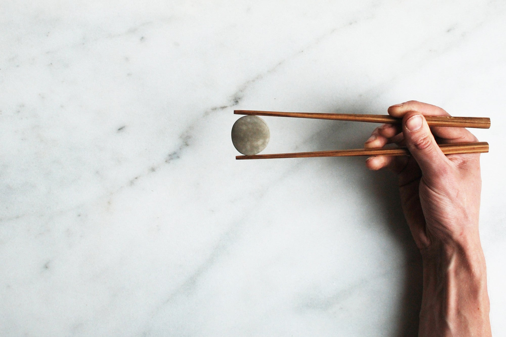 Wooden Chopsticks and Concrete Hypar Rest