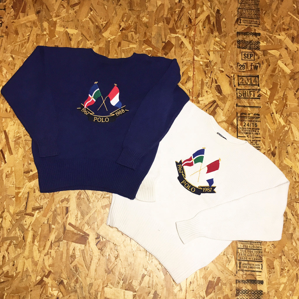 6bd35202473 ... Above - Vintage polo Cross Flags knit sweater blue and white.