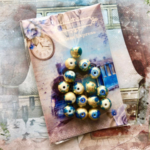 Orient Express - Gold and patina effect beads