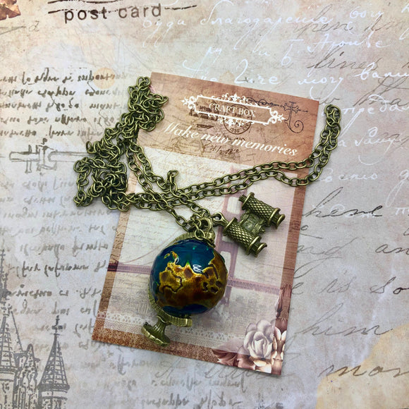 December Replay - Travel Globe Necklace