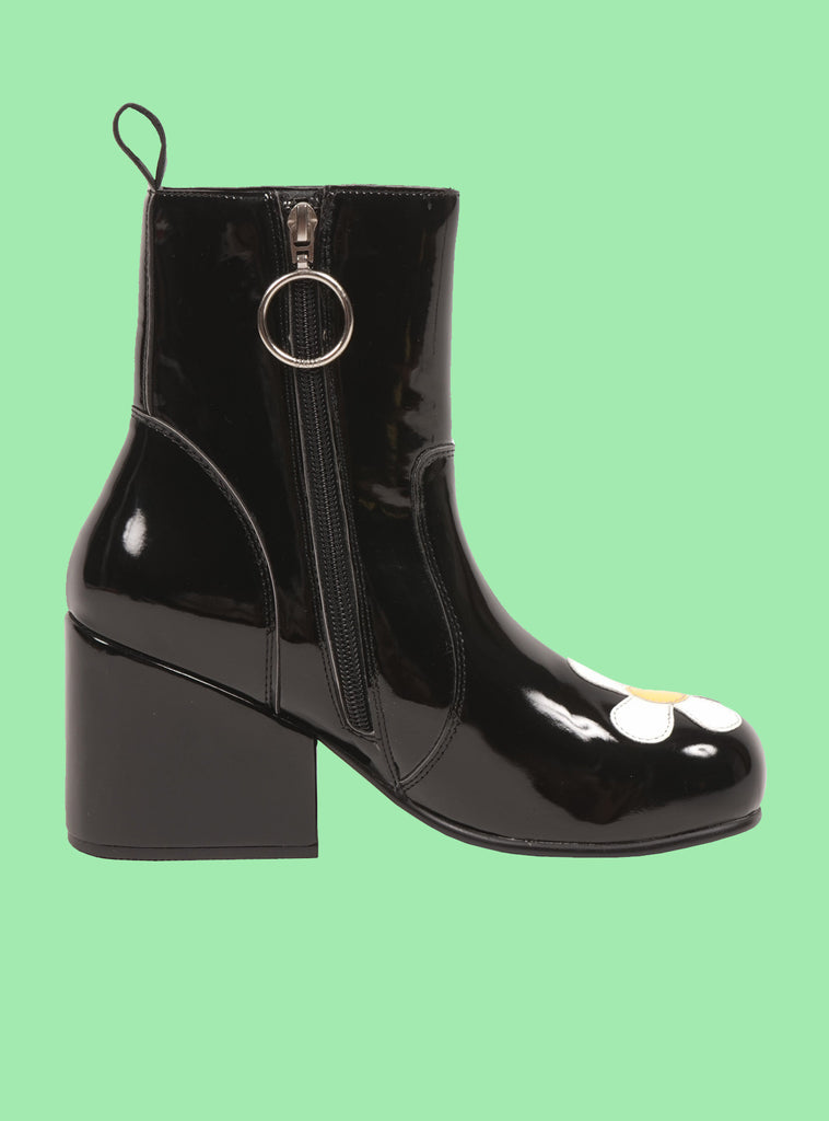UNIF Moxie Daisy Boot. Fit is true to size. 100% Polyurethane.