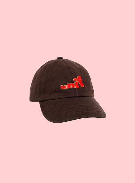 UNIF Swing Logo Hat. Unstructured dad cap in chocolate brown with red 3D logo embroidery. Unisex style.