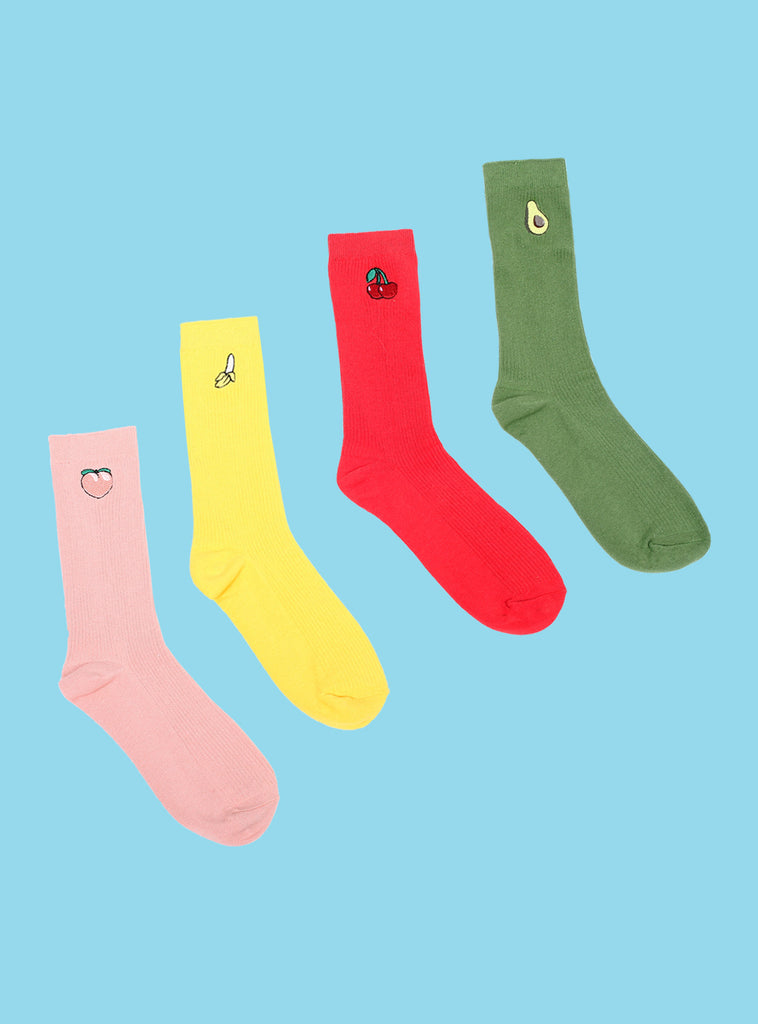 UNIF Fruit Sock 4 Pack including a pair of Peach, Banana, Cherry, and Avocado athletic socks.