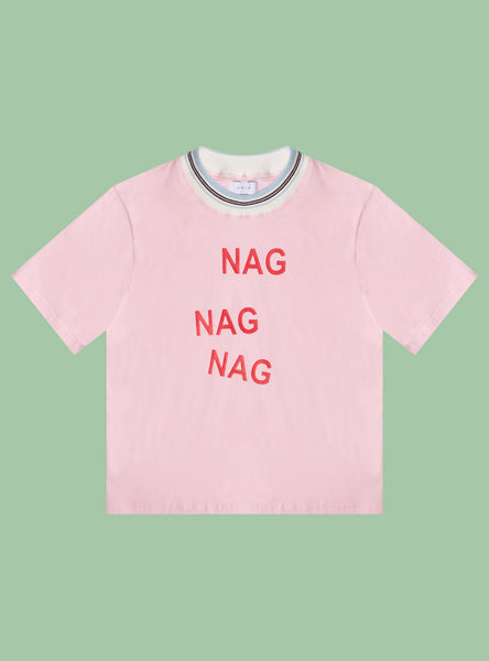 "UNIF Nag Tee. Cropped pink women's knit jersey t-shirt with ribbed contrast color. Printed ""Nag Nag Nag"" graphic on front. 100% Cotton."