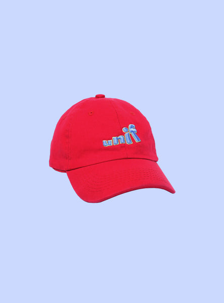 UNIF Swing Logo Hat. Unstructured dad cap in red with blue 3D logo embroidery.