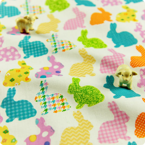 Woodland - white multicoloured Easter rabbit motifs cotton fabric W:100cm FQ1312-28
