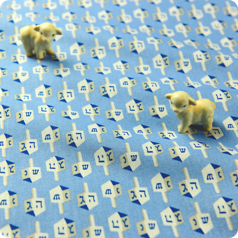 Blue dreidel cotton fabric