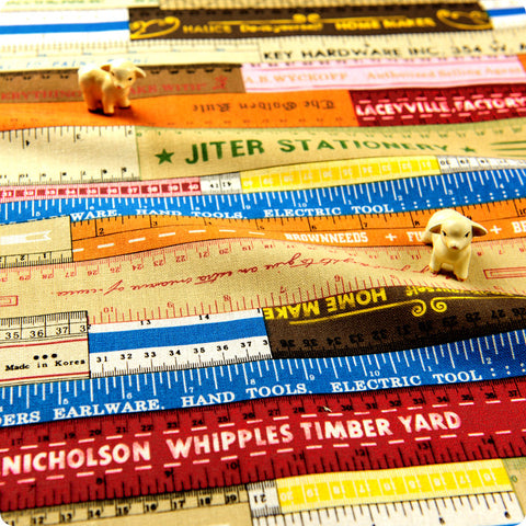 Seamstress - multicoloured distressed measuring tape linen fabric