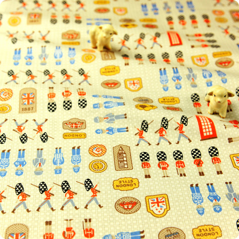 Britannia - beige & blue London toy soldiers cotton fabric