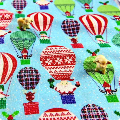 Christmas - blue glitter hot air balloons with Father Christmas & penguins cotton fabric W:108cm FQ1505-01