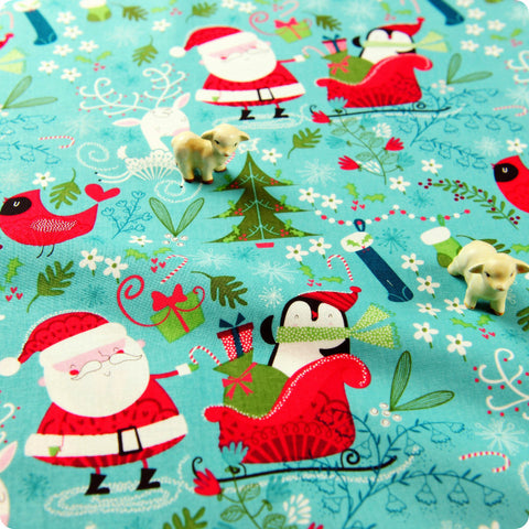 Christmas - blue aqua & red Santa & penguin in sledge cotton fabric W:108cm HM1506-23