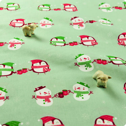 Christmas - green hand-holding snowman & penguin cotton fabric 1506-26