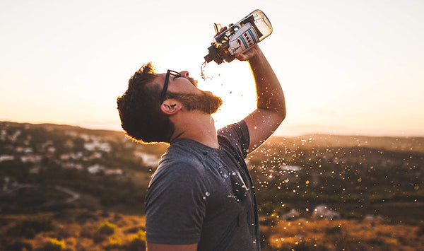 man with beard drinking water