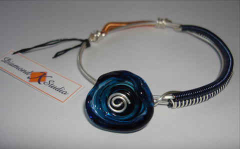 Colored Coil Bangle with Blue Glass Disc Dangle