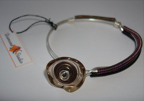 Colored Coil Bangle with Transparent Purple Glass Disc Dangle
